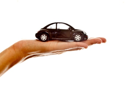 hand holding a black model car on white background Stock Photo - 13075904
