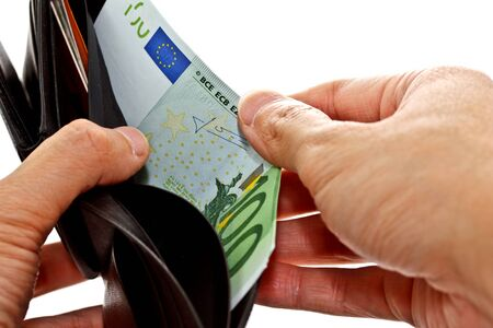 hand keeping 100 Euro banknote from black wallet photo