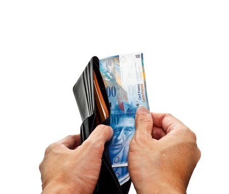 hands opening wallet with Swiss franc banknotes Standard-Bild