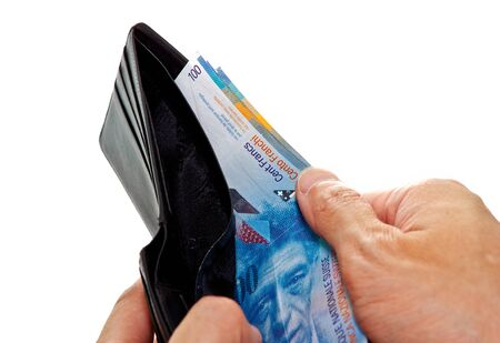 hands opening wallet with Swiss franc banknotes photo