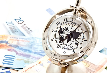 swiss franc: global model clock and Euro banknotes on white background Stock Photo
