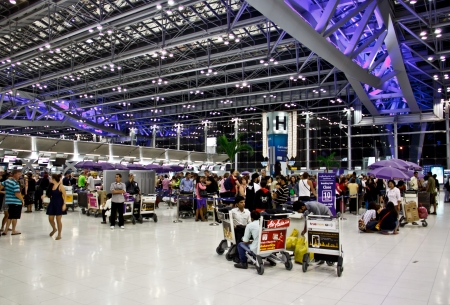Travelers waiting for check-in at Bangkok airport, Thailand