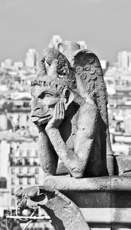 Chimera sculpture and Paris s skyline at the top of Notre Dame Cathedral Stock Photo - 13418780