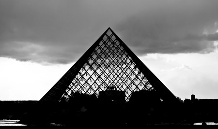 louvre pyramid: silhouette of the glass pyramid at the Louvre museum, Paris
