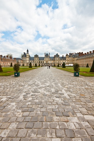 napoleon: Chateau de Fontainebleau with blue sky, France