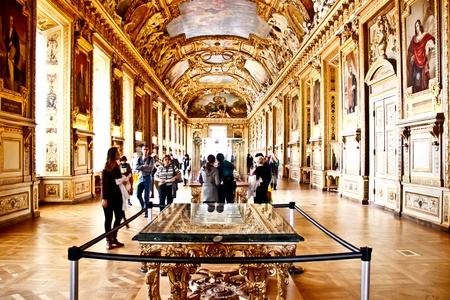 Tourists at the main hall of The Louvre palace