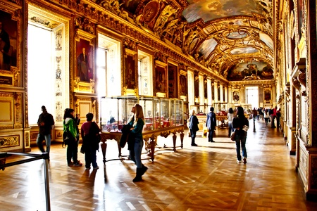 gallery interior: Tourists at the main hall of The Louvre palace