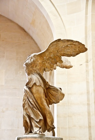 winged: The famous sculpture wings of victory ar  Nike  at Louvre museum, Paris Editorial