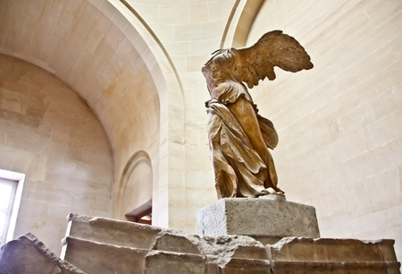 The famous sculpture wings of victory ar  Nike  at Louvre museum, Paris Editorial
