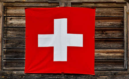 Switzerland flag on old wooden wall photo