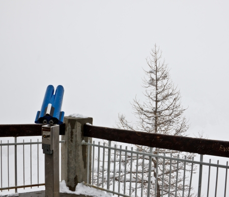 point of view: blue binocular for tourist at a Alpine mountain