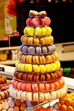 colorful macaroons stacked for sale in dessert shop Stock Photo