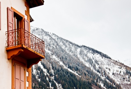 hotel s barcony with Alpine mountain background photo