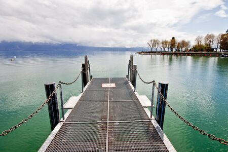 steel pier at Lake Geneva, Lausanne, Switzerland photo