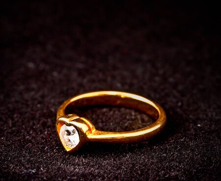 heart shape diamond ring on black background photo