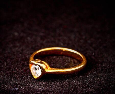 heart shape diamond ring on black background photo