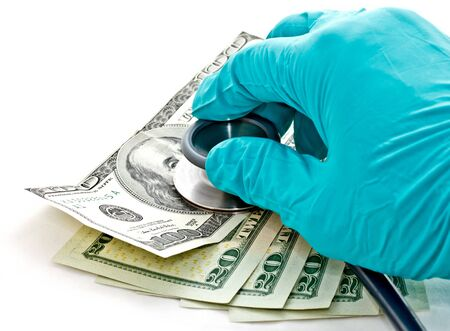 doctor s hand holding stethoscope place on US dollar banknote Stock Photo - 14598040