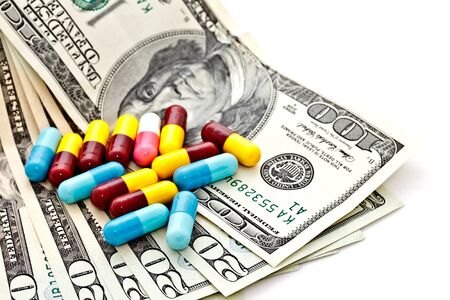 US dollar banknotes with medicine capsules Stock Photo - 14607668