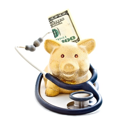 piggy bank and stethoscope on white background Stock Photo - 14607665