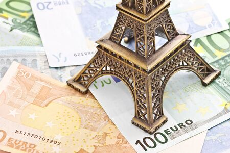 Eiffel tower model with Euro banknotes photo