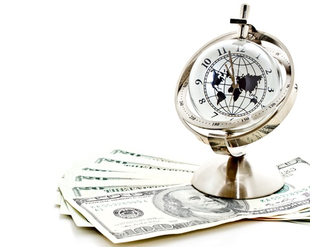 global currencies: global model clock with US dollar banknotes on white background