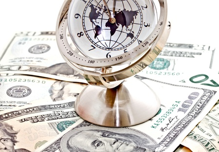 global model clock with US dollar banknotes on white background photo