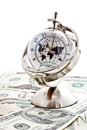 global model clock with US dollar banknotes on white background Stock Photo - 14877184