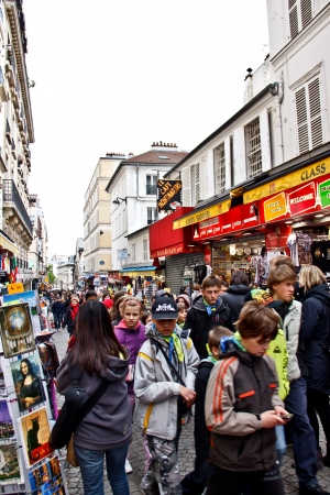 tourists at Montmartre street in Paris, France