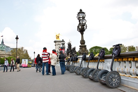 tourists using Segway for city tour in Paris, France