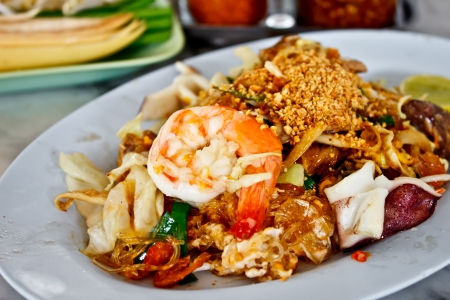 fried noodle with seafood or Padthai, the famous Thai food photo