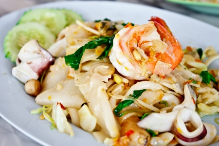 spicy fried noodle with seafood, the delicious Thai food photo