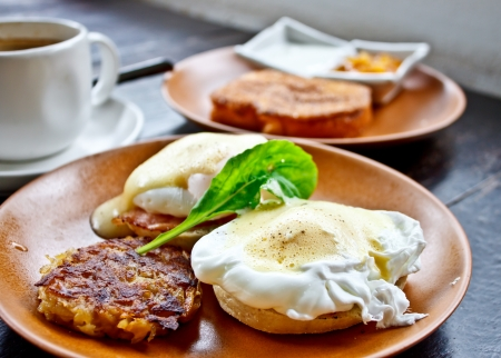 bacon and eggs: Benedict eggs with French toast and coffee