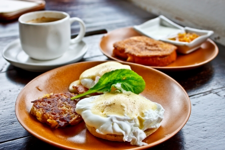 Benedict eggs with French toast and coffee photo