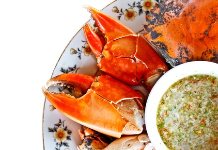 prepared food: isolated steamed crab with Thai spicy seafood sauce on white background Stock Photo