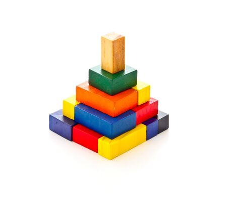 colorful wooden puzzle in pyramid shape on white background Stock Photo - 15793868