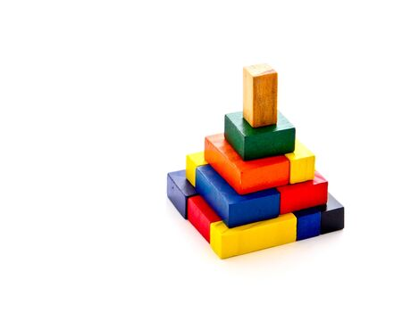 3d art: colorful wooden puzzle in pyramid shape on white background