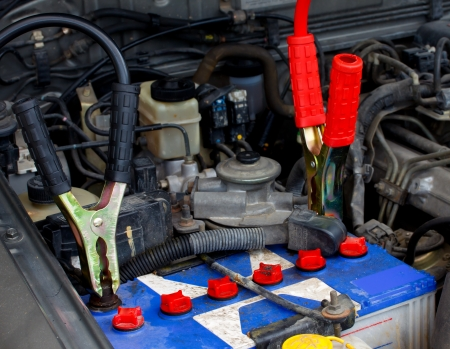 dead car s battery with the jumper to charge the power