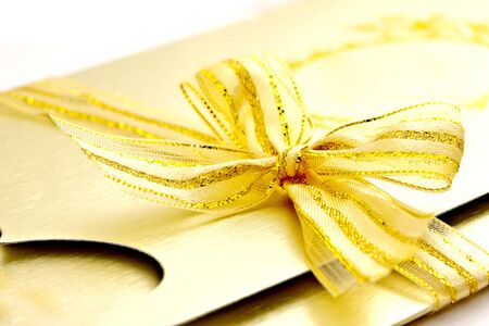 closeup shot of a beautiful wedding card with ribbon photo