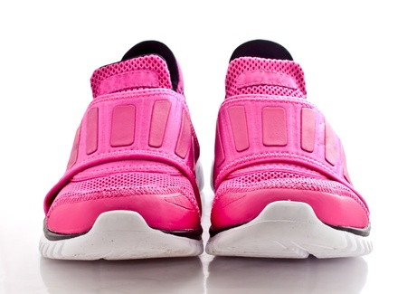 running shoes: lady pinky sport shoes on white background