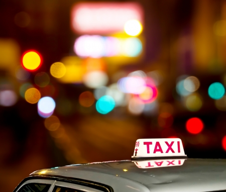 taxi sign with Hong Kong night light