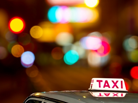 taxi sign with Hong Kong night light photo