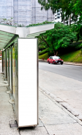 blank sign board at bus stop photo