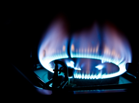 kitchen burner fired on dark background Stock Photo - 16795982