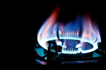 kitchen burner fired on dark background Stock Photo - 16796069
