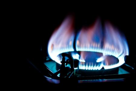 kitchen burner fired on dark background Stock Photo - 16795984
