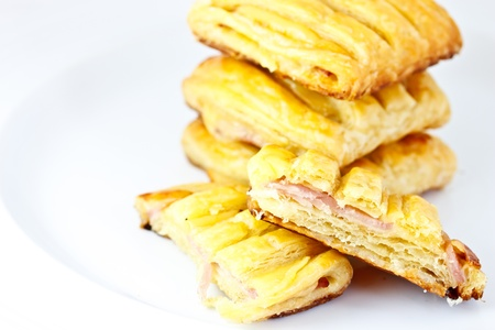 puff pastry: ham cheese pie on white background