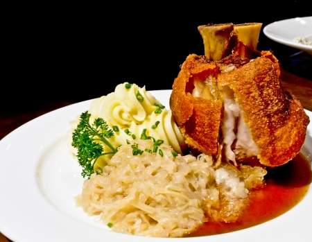 fried pork knuckle with sour cabbage in German style photo
