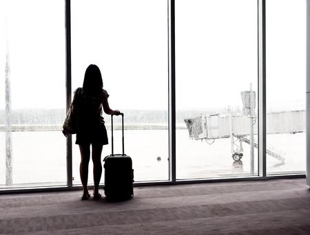 tourist wait for airplane at the airport s terminal