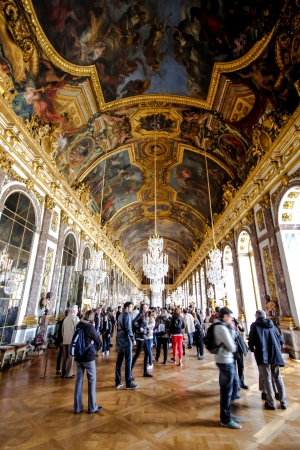 visitors in the hall of mirror inside Versailles palace, France