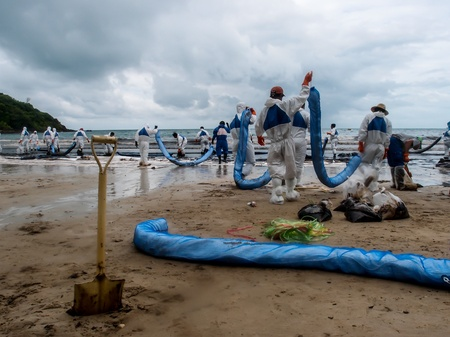 oil spilled beach operation in Rayong, Thailand on July 31, 2013